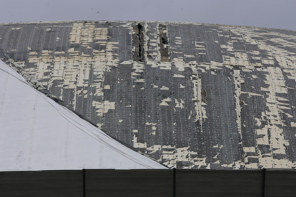 . The roof of the Louisiana Superdome in New Orleans was shredded by strong winds of Hurricane Katrina as it battered the Crescent City on Monday, Aug. 29, 2005. (AP Photo/Bill Haber)