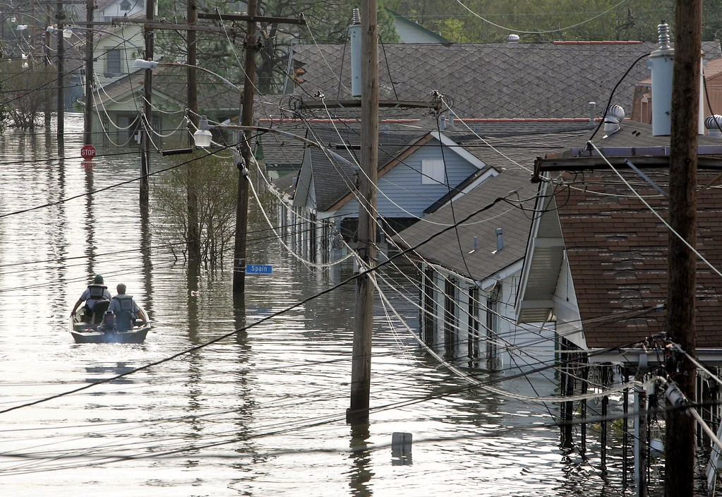 . Rescue personnel search from victims as they traverse the  New Orleans 8th Ward in the flooded city of New Orleans on Tuesday, Aug. 30, 2005. Water continued to rise after the onslaught of Hurricane Katrina which pounded the coast on Monday. (AP Photo/Dave Martin)