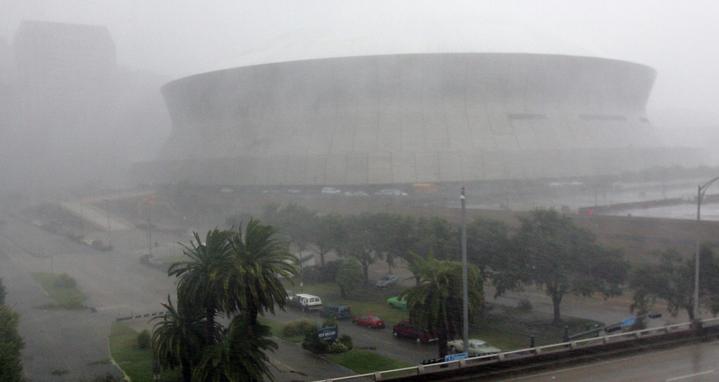 . High winds and rain pound the Louisiana Superdome and New Orleans as Hurricane Katrina made landfall along the Louisiana coast on Monday, Aug. 29, 2005. Officials reported that part of the roof of the Superdome was blown off because of the storm and the facility, which was housing some 10,000 evacuees, was leaking.  (AP Photo/Dave Martin)