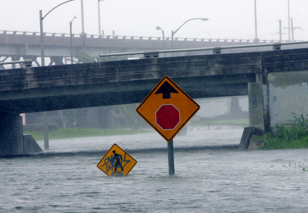 . Heavy floodwaters block many of the roadways in and around New Orleans as Hurricane Katrina pounds the area on Monday, Aug. 29, 2005.  (AP Photo/Dave Martin)