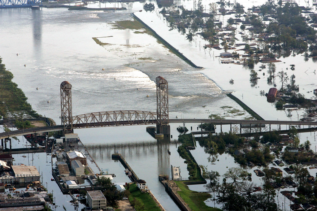 . Floodwaters from Hurricane Katrina flow over a levee along Inner Harbor Navigaional Canal near downtown New Orleans Tuesday, Aug. 30, 2005. Hurricane Katrina did extensive damage when it made landfall on Monday. (AP Photo/David J. Phillip)