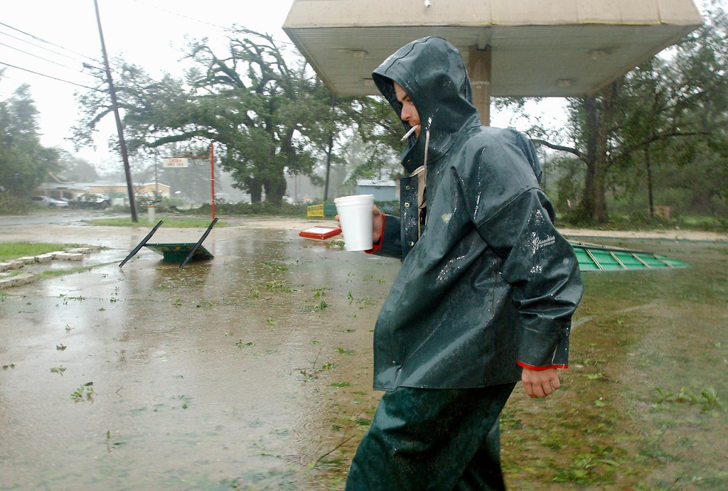 . Chris Gauthreaux bears the winds of Hurricane Katrina on Monday Aug. 29, 2005 in Lacombe, La. as he walks from one business to another where people were taking shelter from the storm. (AP Photo/Mari Darr~Welch)
