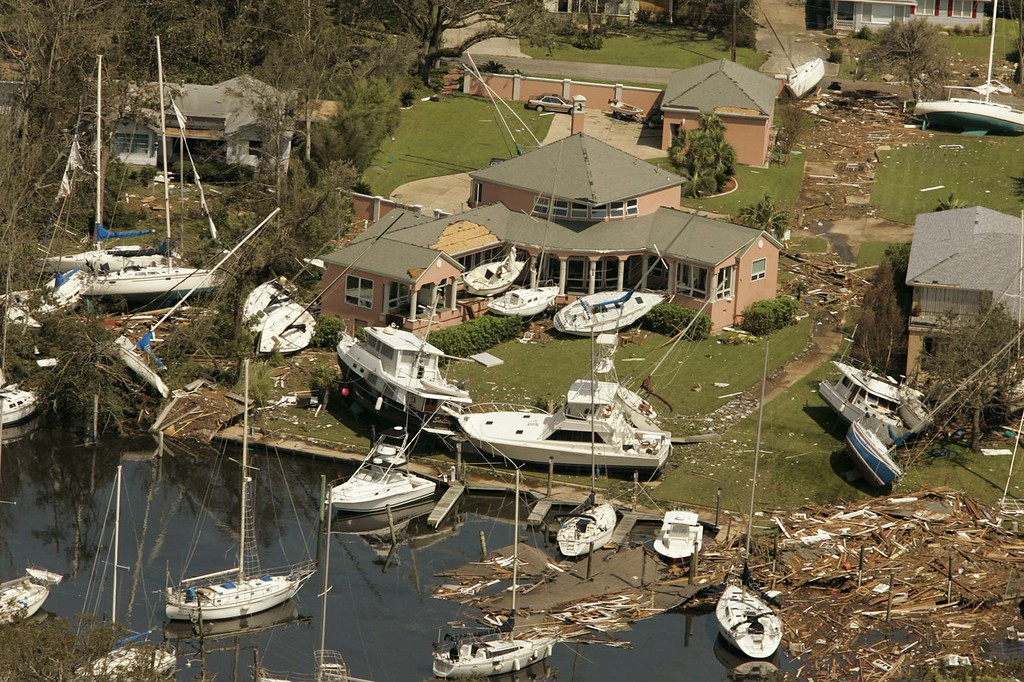 . Boats of all types and sizes sit aground near a waterfront neighborhood in Ocean Springs, Miss., Tuesday, Aug. 30, 2005, following  Hurricane Katrina\'s landfall. (AP Photo/John David Mercer, Pool)