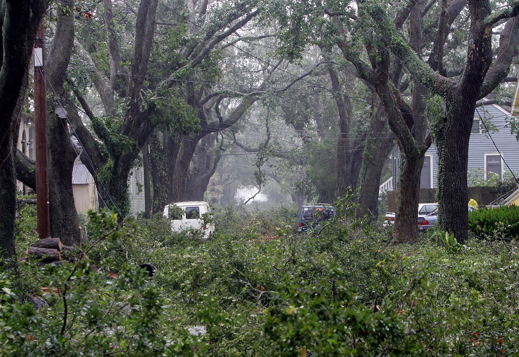 . Trees litter the streets in the uptown section of New Orleans as Hurricane Katrina pounds the Crescent City on Monday, Aug. 29, 2005.  (AP Photo/Dave Martin)