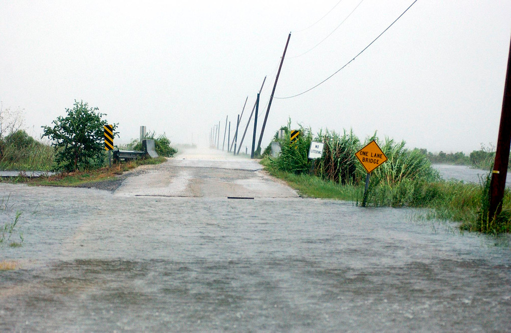 . The waters of Lake Pontchartrain begin to surge on  Monday Aug. 29, 2005 in Lacombe, La. as Hurricane Katrina nears. The eye of the storm was around 100 miles away. (AP Photo/Mari Darr~Welch)