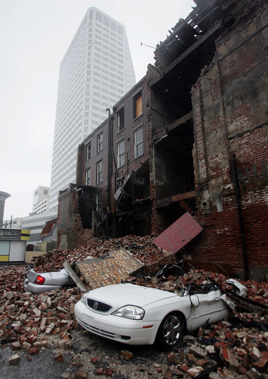 . Debris from a fallen building covers several buildings in downtown New Orleans after Hurricane Katrina battered the Louisiana Coast on Monday, Aug. 29, 2005.  (AP Photo/Dave Martin)