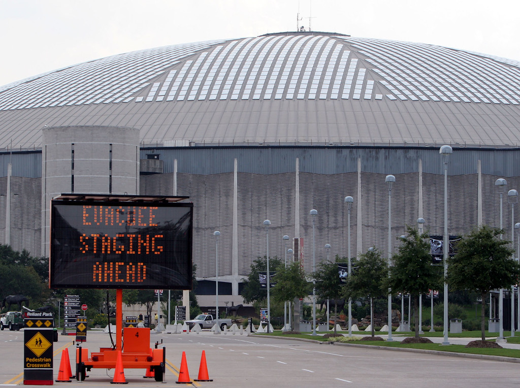 . A sign directs officials and volunteers to the evacuee staging area at the Astrodome in Houston, Wednesday, Aug. 31, 2005. More than 20,000 people affected by Hurricane Katrina are expected to be transported from the New Orleans Superdome to the Astrodome for shelter. (AP Photo/Pat Sullivan)