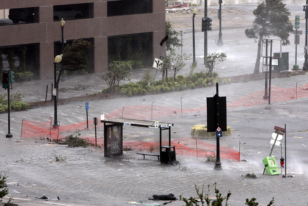 . A downtown New Orleans bus stop is flooded as rain and strong winds from Hurricane Katrina batters the Crescent City on Monday, Aug. 29, 2005.  (AP Photo/Bill Haber)