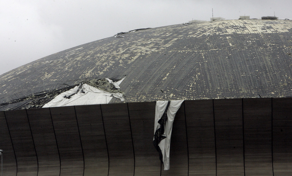 . The roof of the Louisiana Superdome is shredded by strong winds of Hurricane Katrina as it batters the Crescent City on Monday, Aug. 29, 2005. (AP Photo/Bill Haber)