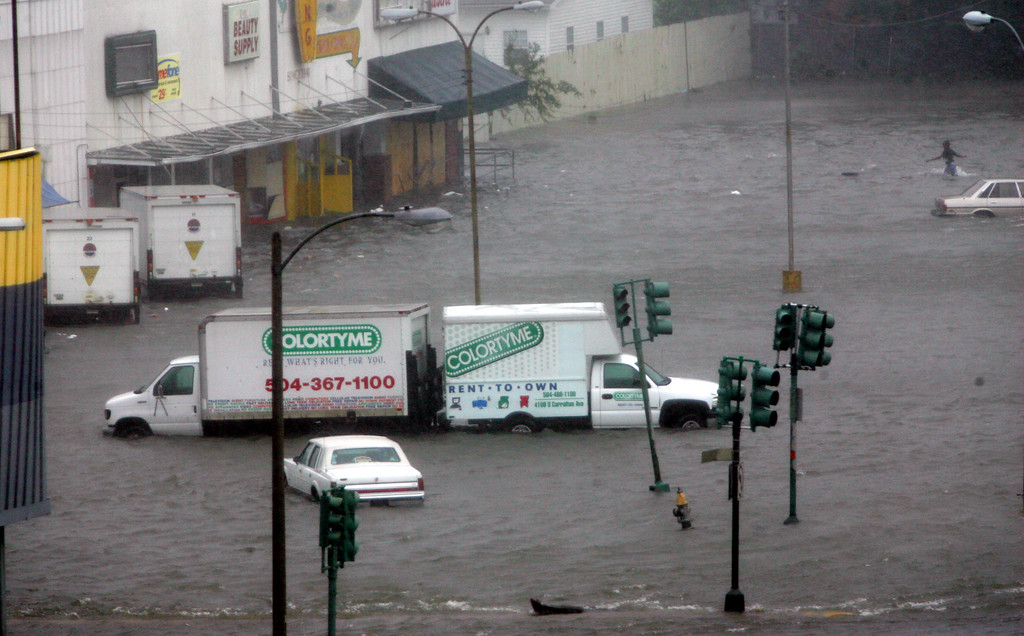 . Floodwaters surround a shopping center after Hurricane Katrina dumped torrential rain and brought 140mph winds to New Orleans on Monday, Aug. 29, 2005. (AP Photo/Dave Martin)