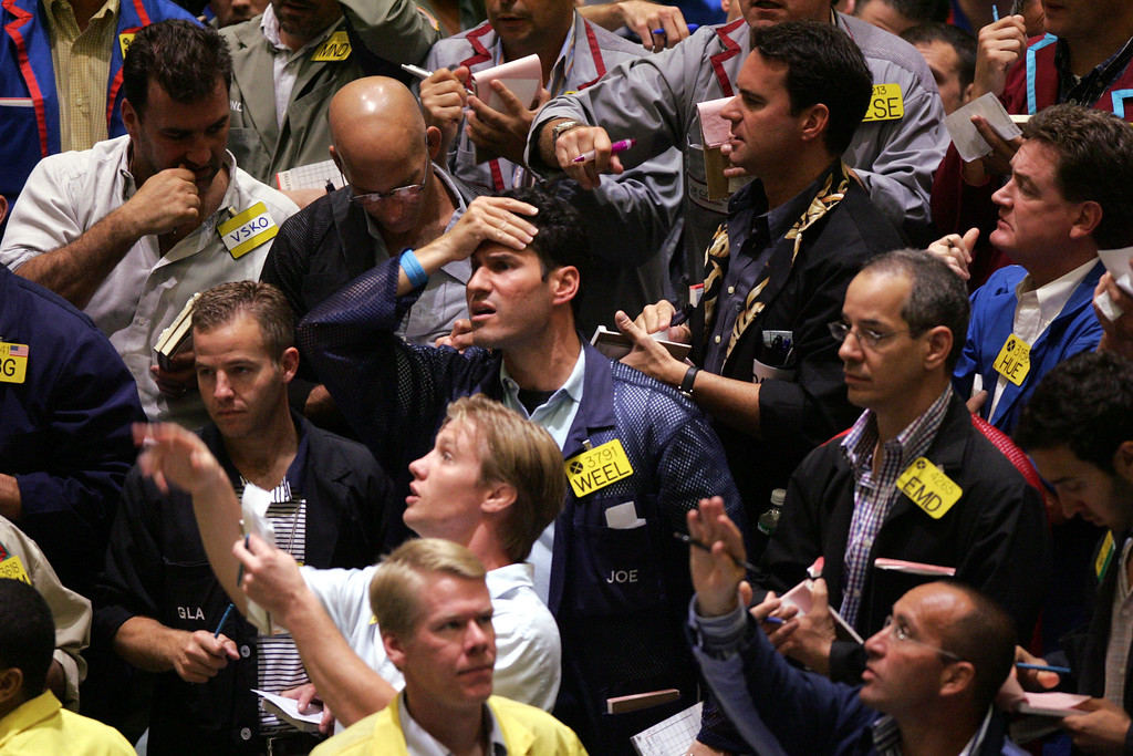 . File - Traders work in the crude oil futures pit at the New York Mercantile Exchange, Monday Aug. 29, 2005. Crude-oil futures briefly surged past $70 a barrel for the first time ever as Hurricane Katrina barreled toward the heart of U.S. oil and refinery operations in the Gulf of Mexico on Monday, shutting down an estimated 1 million barrels of refining capacity. (AP Photo/Mary Altaffer)