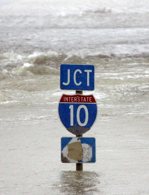 . An Interstate-10 sign is nearly underwater near downtown New Orleans on Monday, Aug. 29, 2005. Hurricane Katrina battered the coast with strong winds and heavy rains when it came ashore near Grand Isle.  (AP Photo/Bill Haber)