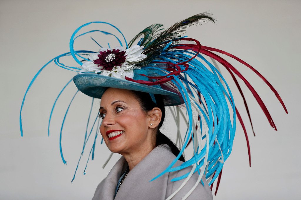 . A woman wears a fancy hat before the 143rd running of the Kentucky Derby horse race at Churchill Downs Saturday, May 6, 2017, in Louisville, Ky. (AP Photo/John Minchillo)