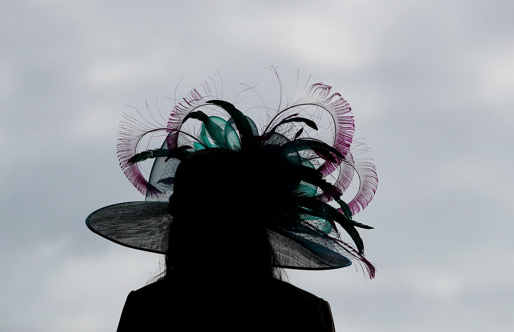 . A woman wears a hat before the 143rd running of the Kentucky Derby horse race at Churchill Downs Saturday, May 6, 2017, in Louisville, Ky. (AP Photo/Charlie Riedel)
