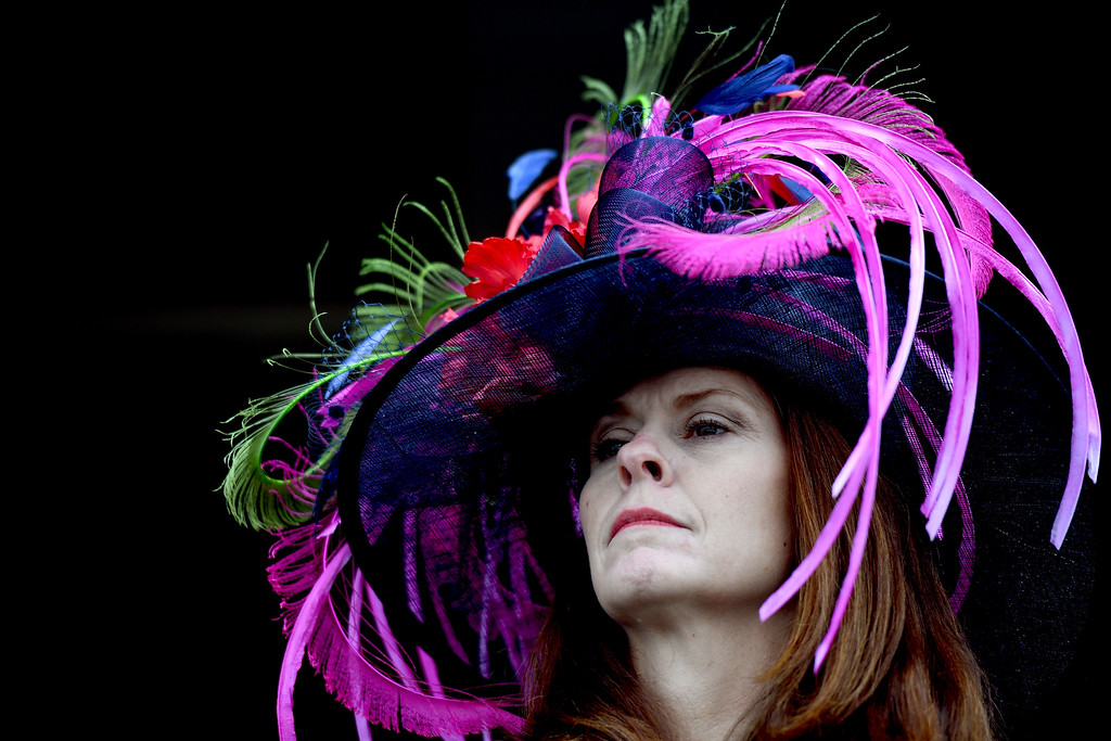 . LOUISVILLE, KY - MAY 06:  A woman wearing a festive hat looks on prior to the 143rd running of the Kentucky Derby at Churchill Downs on May 6, 2017 in Louisville, Kentucky.  (Photo by Bobby Ellis/Getty Images)