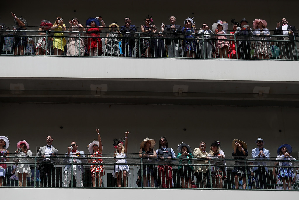 . LOUISVILLE, KY - MAY 06: Fans watch a race prior to the 143rd running of the Kentucky Derby at Churchill Downs on May 6, 2017 in Louisville, Kentucky.  (Photo by Patrick Smith/Getty Images)