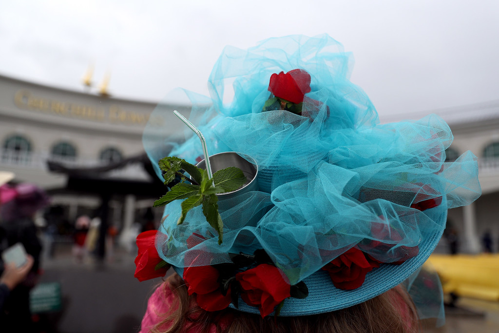 . LOUISVILLE, KY - MAY 06:  A woman wearing a festive hat looks on prior to the 143rd running of the Kentucky Derby at Churchill Downs on May 6, 2017 in Louisville, Kentucky.  (Photo by Patrick Smith/Getty Images)