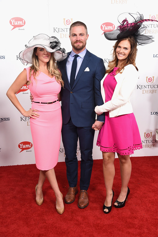 . LOUISVILLE, KY - MAY 06:  Stephen Amell (C) and Cassandra Jean (R) attend the 143rd Kentucky Derby at Churchill Downs on May 6, 2017 in Louisville, Kentucky.  (Photo by Michael Loccisano/Getty Images for Churchill Downs)