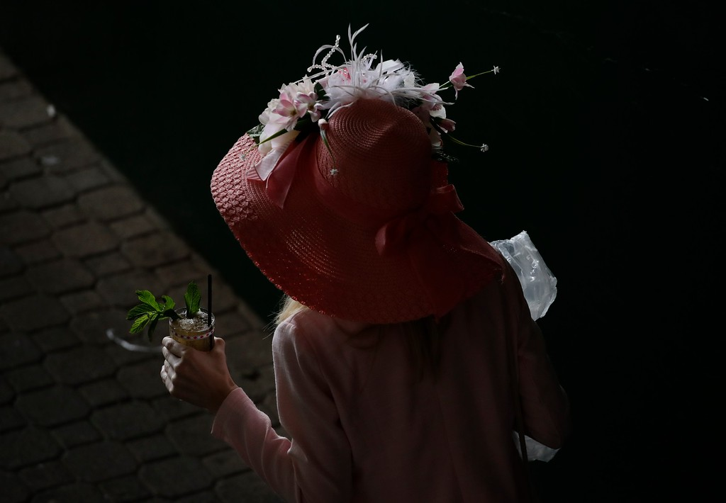 . W oman holds a mint julep before the 143rd running of the Kentucky Derby horse race at Churchill Downs Saturday, May 6, 2017, in Louisville, Ky. (AP Photo/Charlie Riedel)