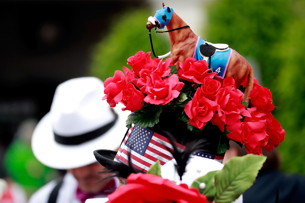 . LOUISVILLE, KY - MAY 06:  A man wearing a festive hat looks on prior to the 143rd running of the Kentucky Derby at Churchill Downs on May 6, 2017 in Louisville, Kentucky.  (Photo by Gregory Shamus/Getty Images)