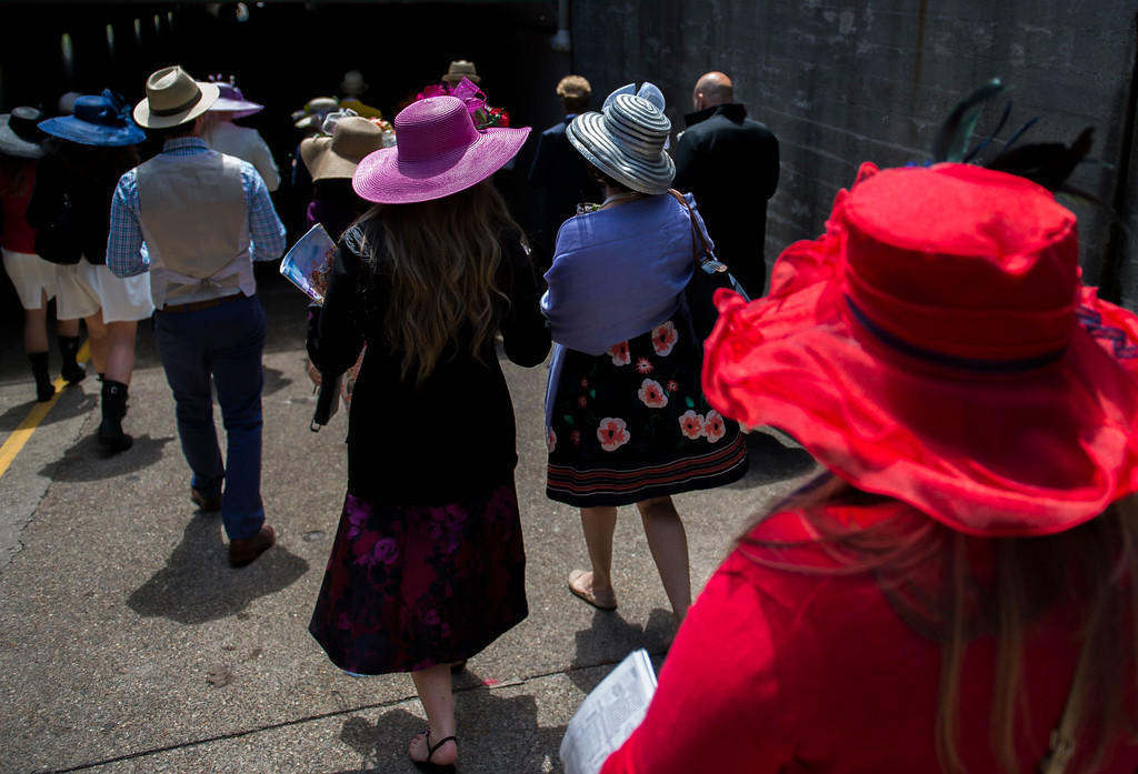 . LOUISVILLE, KY - MAY 6:   Derby goers leave the grandstand area and head to the infield at the 143rd Kentucky Derby at Churchill Downs on May 6, 2017 in Louisville, Kentucky. (Photo by Michael Noble Jr./Getty Images)