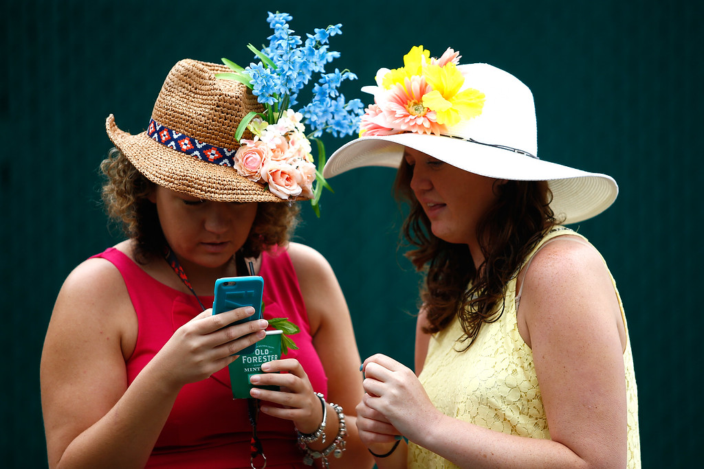 . LOUISVILLE, KY - MAY 06: Women wearing festive hats look on prior to the 143rd running of the Kentucky Derby at Churchill Downs on May 6, 2017 in Louisville, Kentucky. (Photo by Shaban Athuman/Getty Images)