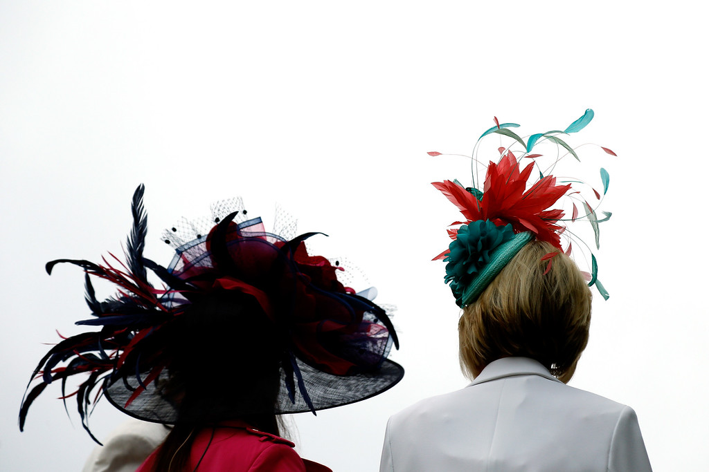 . LOUISVILLE, KY - MAY 06:  Women wearing festive hats look on prior to the 143rd running of the Kentucky Derby at Churchill Downs on May 6, 2017 in Louisville, Kentucky.  (Photo by Michael Reaves/Getty Images)