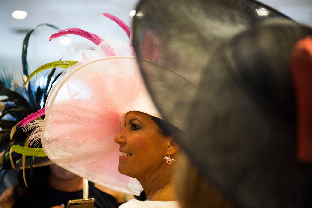 . LOUISVILLE, KY - MAY 6: Donna Price of Bardstown, Kentucky laughs with friends as they attend the 143rd Kentucky Derby at Churchill Downs on May 6, 2017 in Louisville, Kentucky. (Photo by Michael Noble Jr./Getty Images)