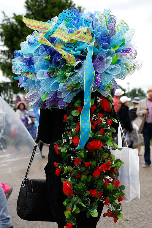 . LOUISVILLE, KY - MAY 06:  A woman wearing a festive hat looks on prior to the 143rd running of the Kentucky Derby at Churchill Downs on May 6, 2017 in Louisville, Kentucky.  (Photo by Michael Reaves/Getty Images)