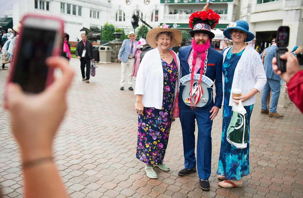 . LOUISVILLE, KY - MAY 6: Derby goers pose with Grey Faulkner before the 143rd Kentucky Derby  at Churchill Downs on May 6, 2017 in Louisville, Kentucky. (Photo by Michael Noble Jr./Getty Images)