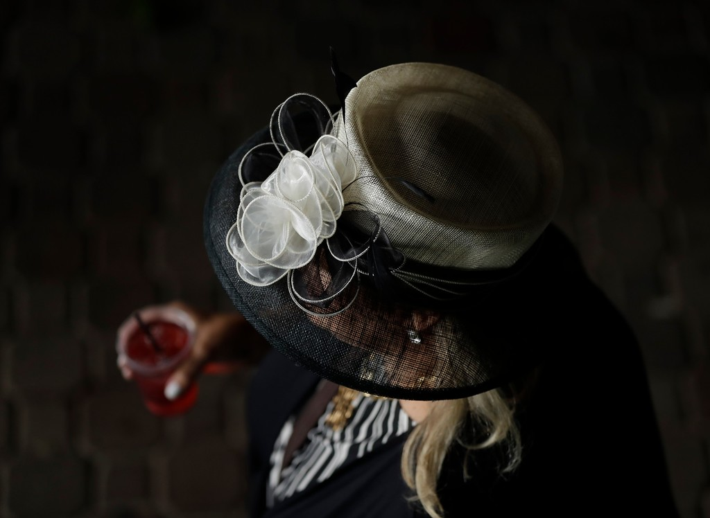 . A woman wears a fancy hat before the 143rd running of the Kentucky Derby horse race at Churchill Downs Saturday, May 6, 2017, in Louisville, Ky. (AP Photo/Matt Slocum)