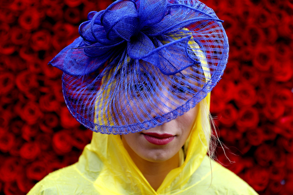 . LOUISVILLE, KY - MAY 06:  A woman wearing a festive hat poses prior to the 143rd running of the Kentucky Derby at Churchill Downs on May 6, 2017 in Louisville, Kentucky.  (Photo by Patrick Smith/Getty Images)