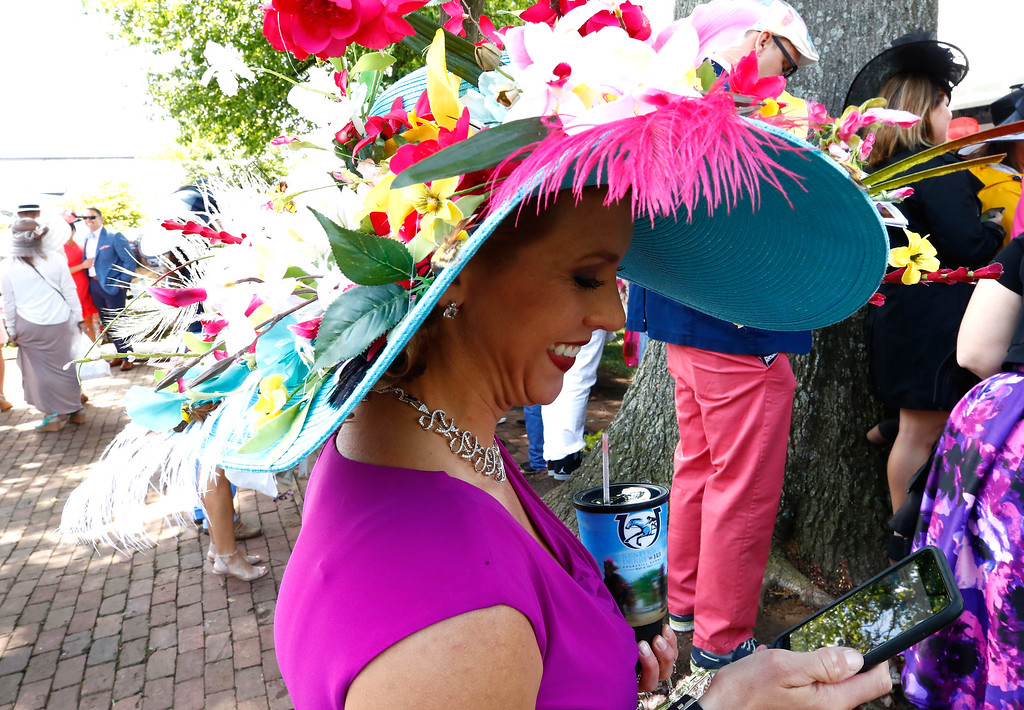 . LOUISVILLE, KY - MAY 06:  A woman wearing a festive hat looks on prior to the 143rd running of the Kentucky Derby at Churchill Downs on May 6, 2017 in Louisville, Kentucky.  (Photo by Gregory Shamus/Getty Images)