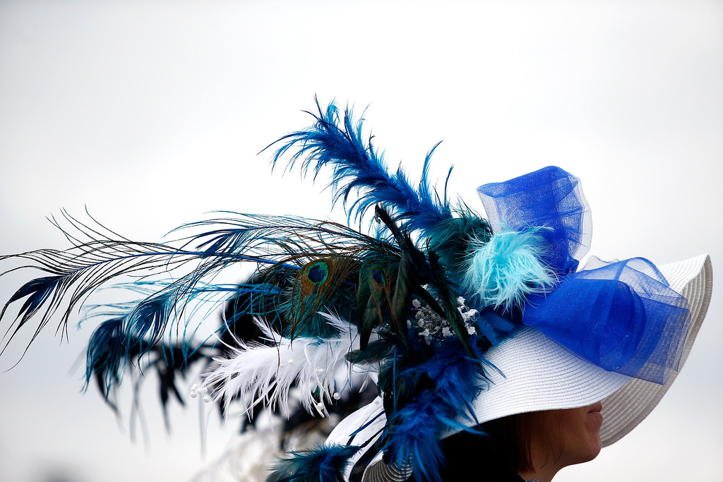 . LOUISVILLE, KY - MAY 06:  A woman wearing a festive hat looks on prior to the 143rd running of the Kentucky Derby at Churchill Downs on May 6, 2017 in Louisville, Kentucky.  (Photo by Getty Images/Getty Images)
