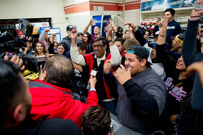 7-Eleven assistant manager M. Faroqui, center, celebrates after selling the winning $1.5 billion Powerball Lottery ticket in Chino Hills, Calif. on Wednesday night, Jan. 13, 2016.  (Photo by Watchara Phomicinda/ Los Angeles News Group)