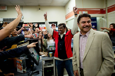 7-Eleven store owner Balbir Atwal, right, and assistant manager M. Faroqui, celebrate after selling the winning $1.5 billion Powerball Lottery ticket in Chino Hills, Calif. on Wednesday night, Jan. 13, 2016 (Photo by Watchara Phomicinda/ Los Angeles News Group)