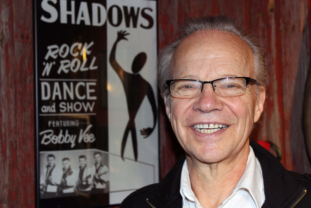 . In this photo made Dec. 18, 2013, Bobby Vee poses at his family\'s Rockhouse Productions in St. Joseph, Minn. Alzheimer\'s disease forced the 1960s pop idol to stop performing in 2011. (AP Photo/Jeff Baenen)