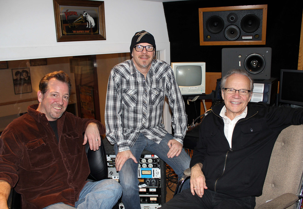 . In this photo made Dec. 18, 2013, Bobby Vee poses with sons Jeff Vee, left, and Tommy Vee, right, at his family\'s Rockhouse Productions in St. Joseph, Minn. Alzheimer\'s disease forced the 1960s pop idol Vee to stop performing in 2011. (AP Photo/Jeff Baenen)