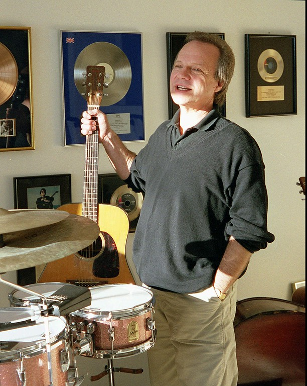 . Bobby Vee stands with memorabilia from his early years as a rock \'n\' roll singer, Monday, Jan. 25, 1999, in Fargo, N.D.  Vee, originally from Fargo, got his start 40 years ago filling in for Buddy Holly the day after Holly died. (AP Photo/John MacDonald)
