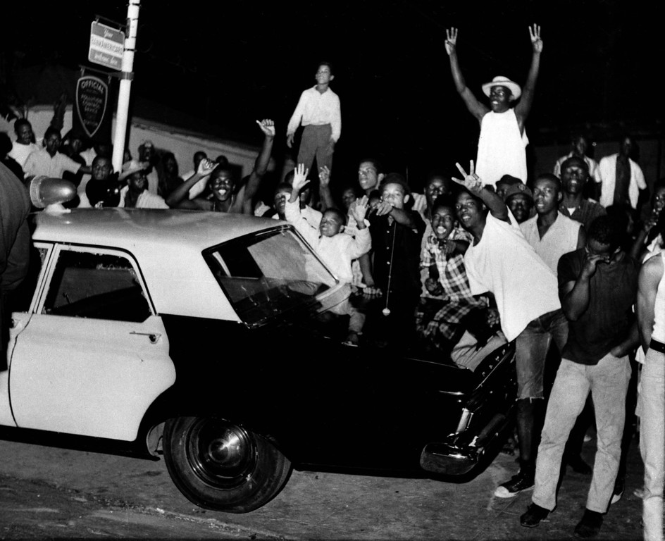 . Demonstrators push against a police car after rioting erupted in a crowd of 1,500 in the Los Angeles area of Watts, August 12, 1965. The disturbances were triggered by the arrest of a black person on charges of drunken driving. More than 100 officers were called into the area. (AP Photo)