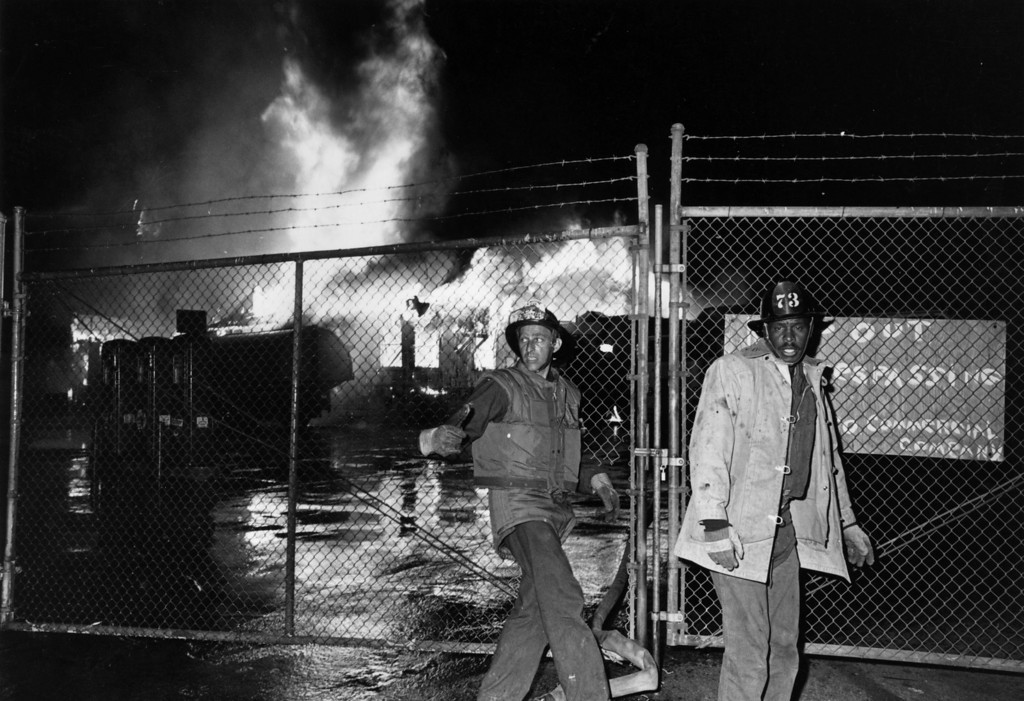 . Fire-fighters in front of a blazing building during the Watts Riots in Los Angeles, California, 11th-15th August 1965.  (Photo by Harry Benson/Express/Getty Images)