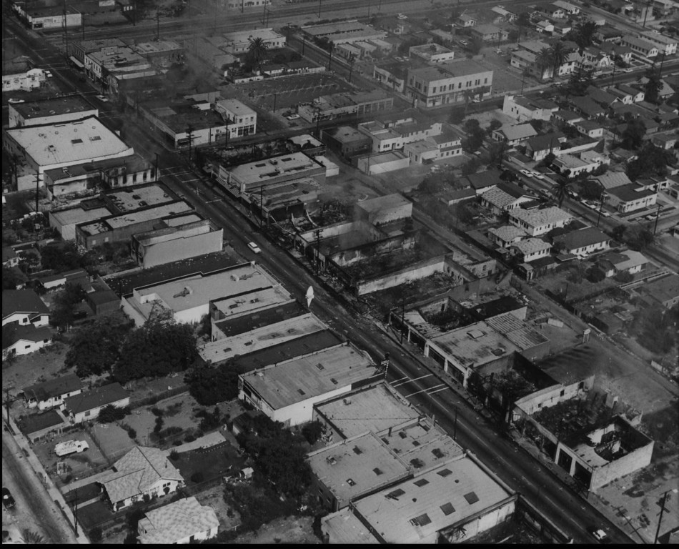 . Buildings burn along a Los Angeles street in the Watts section during riots in this file photo taken Aug. 14, 1965.(AP Photo/File)