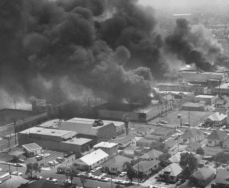 . 1965: Aerial view shows several buildings on fire at the same time, during the rioting in the Watts area.  (Los Angeles Public Libary)