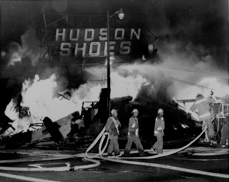 . A shoe store in the Watts area of Los Angeles, CA, collapses in flames as the city\'s wave of violence moves into it\'s fourth day, August 14, 1965.  (AP Photo)