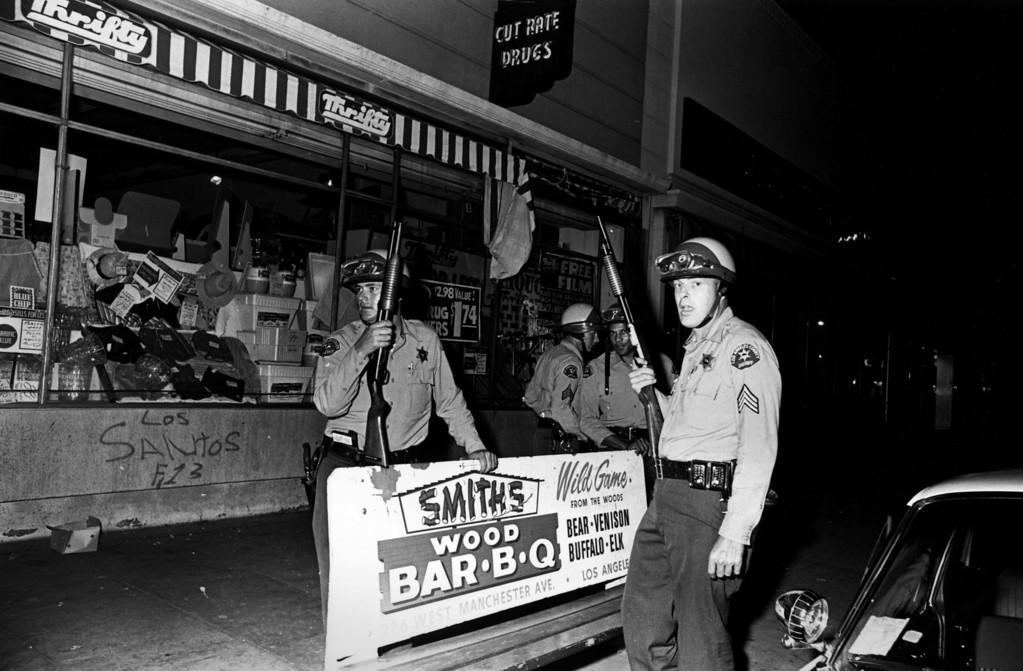 . Armed police patrolling the streets of Los Angeles during the Watts race riots, 11th-15th August 1965. (Photo by Harry Benson/Express/Getty Images)
