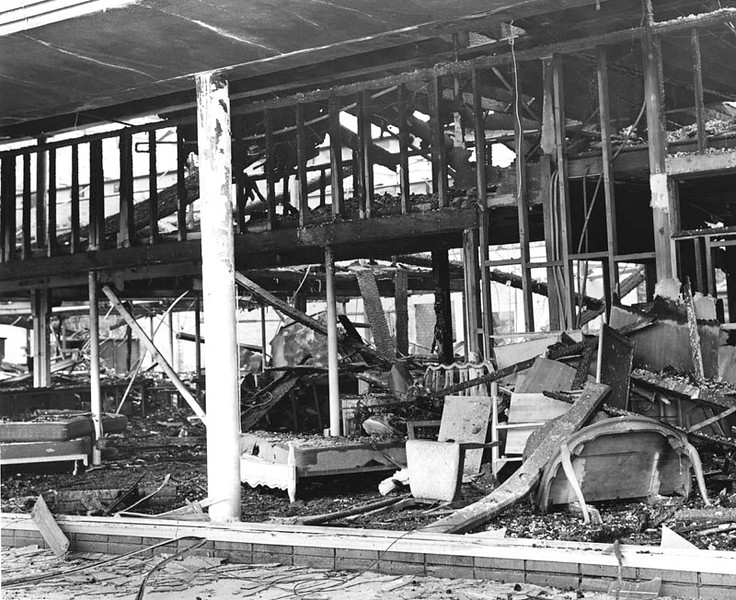 . View of a furniture store at 41st Place and Broadway, gutted and destroyed by fire during the Watts Riots. Photo dated: August 16, 1965. (Los Angeles Daily News)