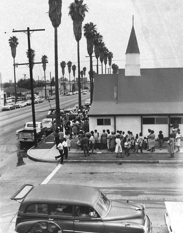 . 1965 Watts Riots: People are lined up at a local church in the Watts area. The church was offering assistance after the riots.  (Los Angeles Public Library)