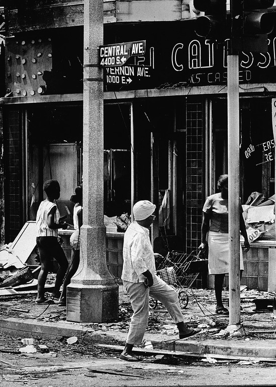 . A group of Black women step through rubble and demolished storefronts on Central and Vernon Avenues where businesses were destroyed and looted during the Watts riots in Los Angeles, California, August 1965. (Photo by Hulton Archive/Getty Images)