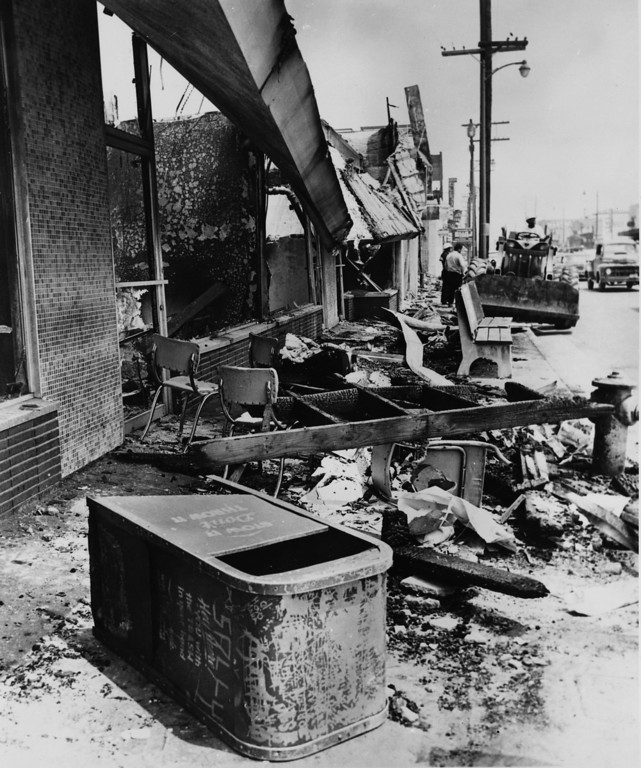 . 25th August 1965: A bulldozer clears debris in the aftermath of racially motivated riots that hit Los Angeles a week earlier.   (Photo by Central Press/Getty Images)