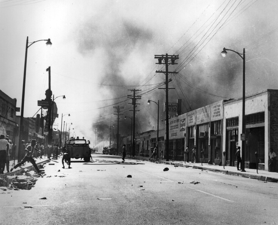. 1965: Protestors on the burned out streets of the Watts District after the race riots in Los Angeles.   (Photo by Keystone/Getty Images)